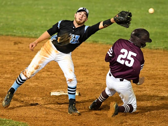 Union County's Trey Hutchison, who was playing shortstop during the 2017 season, tries to make the tag on Henderson County's Jake Murdach during last year's Sixth District Tournament championship game.