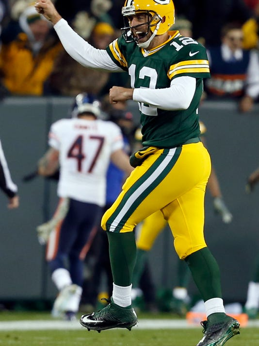 Green Bay Packers quarterback Aaron Rodgers (12) celebrates a touchdown during the first half of an NFL football game against the Chicago Bears Sunday, Nov. 9, 2014, in Green Bay, Wis. (AP Photo/Mike Roemer)