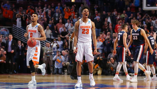 Syracuse guard Malachi Richardson (23) and forward Michael Gbinije (0) react against the Gonzaga Bulldogs during the second half in a semifinal game in the Midwest Regional of the NCAA Tournament.