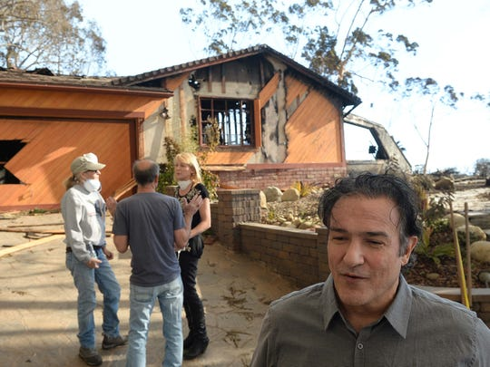 Nick Bonge, right, of Ventura, and wife Adele Bonge, talk with neighbors David Carlson and Amy Crittenden before they dig through rubble for lost possessions on Thursday morning.