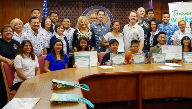 On May 12, Acting Gov. Ray Tenorio signed a proclamation that designated May 2017 as Tourism Month. Pictured: Acting Gov. Ray Tenorio, Guam Visitors Bureau and Tourism Education Council representatives, Tourism Works contest winners.