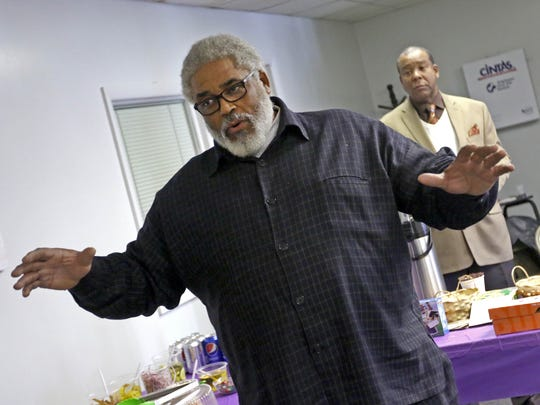 C. Eugene Brocks, of New Jerusalem Missionary Baptist Church, speaks during a community event Wednesday in Wilmington about the fire that burned down his church. The event was organized to address vandalism and violence in the northeast part of the city.