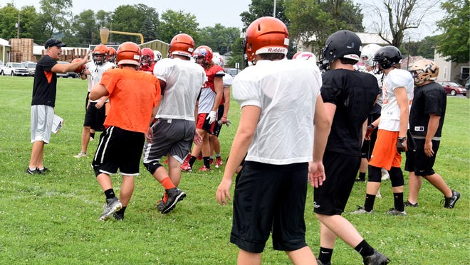 Ridgewood coach John Slusser talks to his team during all-star practice on Thursday. Slusser will coach the West squad in the 40th annual Times-Reporter All-Star football game on Friday at Woody Hayes Quaker Stadium in New Philadelphia.