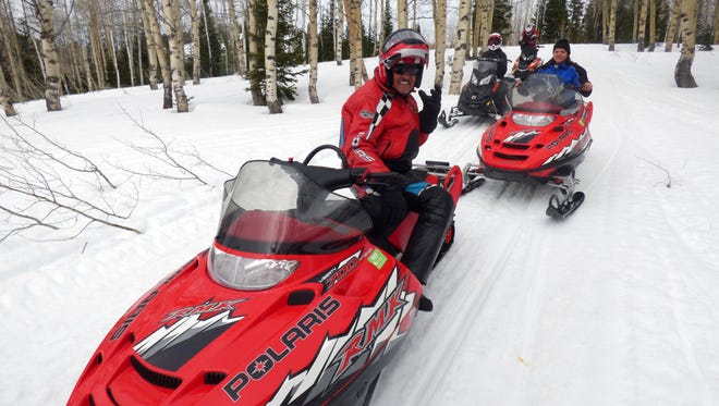 Richard Petty (left) on a snowmobiling trip in the Wyoming mountains near his home in Alpine.