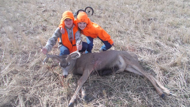 Briana Robins, left, took this mule deer buck on the Hillside Colony in North Toole County.