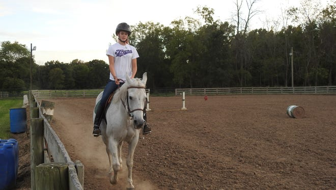 Katie Schorr rides her horse, Cierra, during an English riding lesson at Serenity Acres in Nashport.