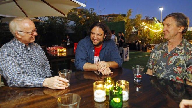 Arizona Republic food critic Dominic Armato, center, talks with guests Saturday, Nov. 7, 2015 at the azcentral.com Food & Wine Experience in Scottsdale.