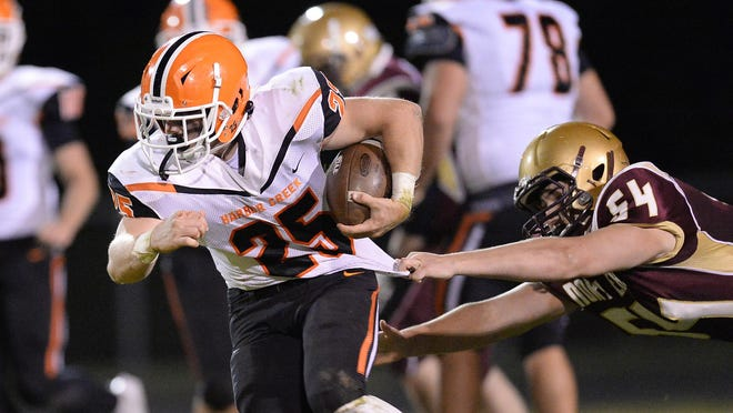 Harbor Creek junior Cam Williamson, left, tries to pull away from North East senior Wil Parton in the second half at Ted Miller Stadium on Friday, Sept. 18, 2020, in North East.