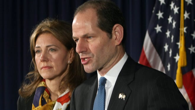 Eliot Spitzer, with wife Silda Wall, on March 12, 2008, announcing he would resign as New York governor amid a sex scandal.