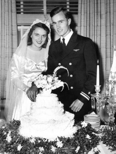 George and Barbara Bush cut their wedding cake in Rye,