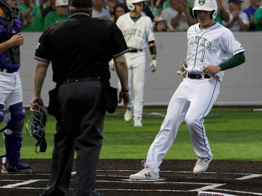 Iowa Park's Trent Green steps on home to score against Abilene Wylie Friday, May 18, 2018, in Iowa Park. Wylie defeated Iowa Park 4-2 in Game 1 of the Region I-4A quarterfinals.