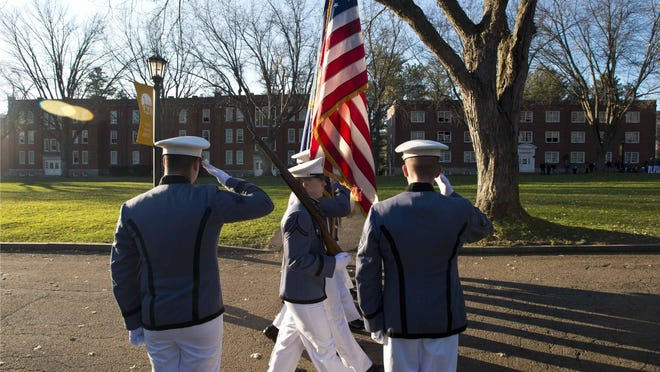 The Norwich University corps of cadets marches during Veterans Day observances in Northfield on November 11, 2014.