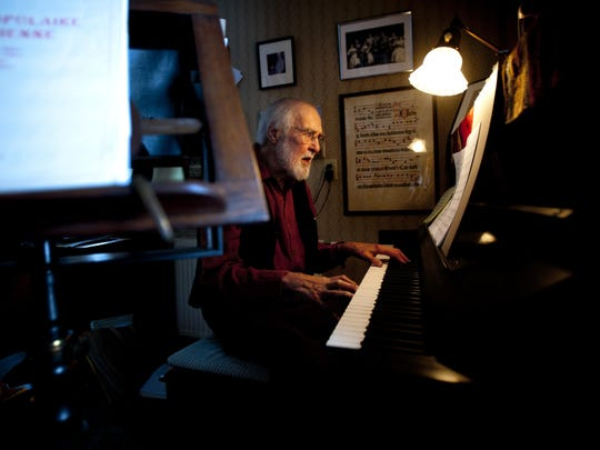 Robert De Cormier, the founder of the Vermont Symphony Orchestra Chorus and Counterpoint Chorus, sits at the piano at his Belmont home in 2014.