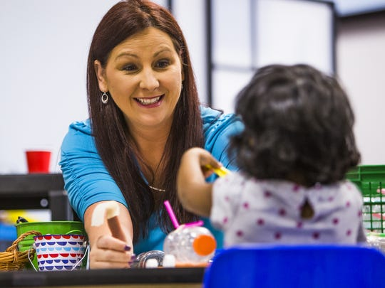 Tracie Younce, founder of New World Learning Academy, a STEM-based preschool that aims to give kids a head start in education, teaches a science and engineering class to pre-kindergarten and kindergarten children, Wednesday, May 16, 2018. She works with Nihira Indukuri, 3.