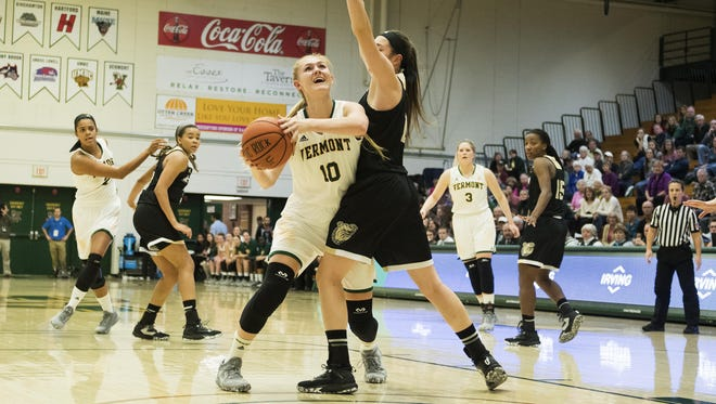 Catamounts forward Hanna Crymble (10) leaps for a lay up during the women's basketball game between the Bryant Bulldogs and the Vermont Catamounts at Patrick Gym on Friday night November 11, 2016 in Burlington.