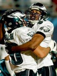 Philadelphia Eagles wide receiver James Thrash, left,