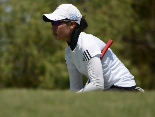 Taiwan's Jo Hua Hung prepares to putt on No. 17 during