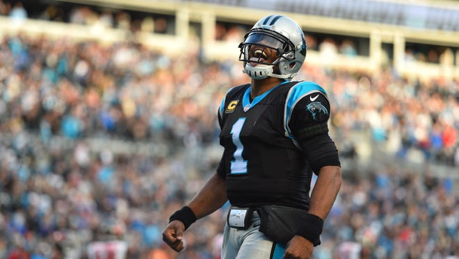 Carolina Panthers quarterback Cam Newton (1) celebrates after scoring a touchdown in the fourth quarter at Bank of America Stadium.