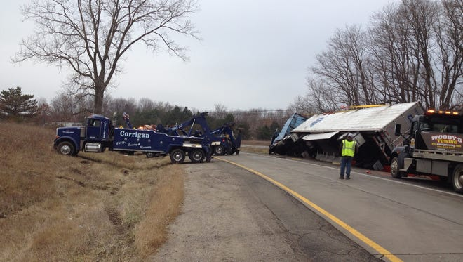 Michigan State Police said a truck hauling 38,000 pounds of bananas rolled over Sunday afternoon on the ramp from northbound U.S. 23 to westbound Interstate 96 around 11:30 a.m. in Brighton Township.
