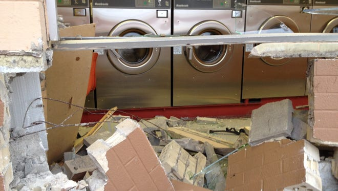 A minivan damaged the Quick Clean laundromat when it struck the building Friday morning.