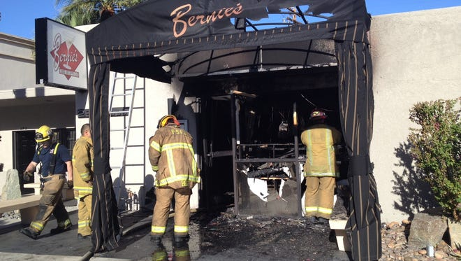Palm Springs firefighters investigate a blaze that destroyed Bernie's Lounge and Supper Club, 292 E. Palm Canyon  Drive.