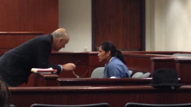 Esmeralda Martinez speaks with her attorney, Ben Schiff, in Riverside County Superior Court Monday.