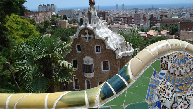 Gaudí's whimsically designed tile bench at Park Güell gives way to stunning views of the Mediterranean Sea and other Gaudí architectural masterpieces.