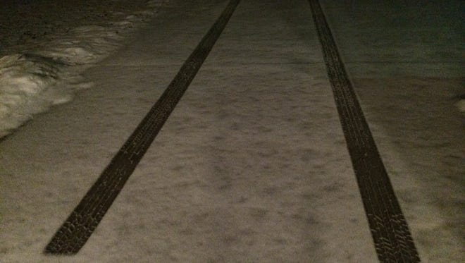 A layer of snow had fallen by early Sunday morning.