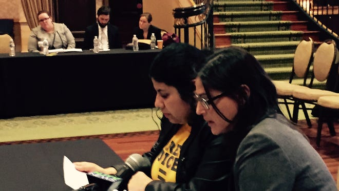 Camden mother Adayne Izquierdo ( right) asks Assembly budget committee through  a Spanish interpreter to give more money to charter schools like Freedom Prep, where her daughter attends, during a public state budget hearing at Scottish Rite Ballroom in Collingswood. Charters get less state aid than regular public schools.