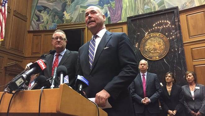 Indiana House Speaker Brian Bosma (right) and Senate President Pro Tempore David Long announce proposed changes Thursday to REFA.