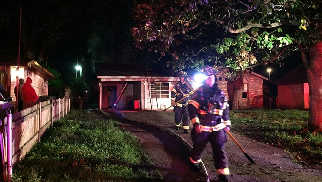 Bossier City firefighters at a house in the 3900 block of Ella Street.