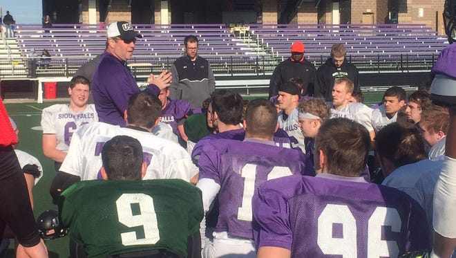 Jed Stugart addresses his team after a Saturday morning scrimmage.