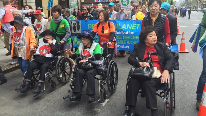 Hiroshima survivor Setsuko Thurlow, at right, participates in a march against nuclear weapons Sunday, April 26, 2015, in New York. At 83, she is part of a generation of nuclear attack survivors that is quickly disappearing. (AP Photo/Cara Anna)