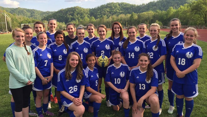 Kirstyn Lamb (2) and the rest of the Highlands girls soccer team.