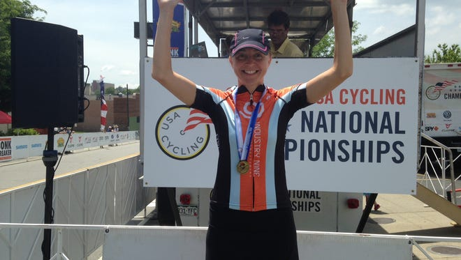 Karen Ostergaard wins gold in the USA Cycling Road National Championships in Asheville Saturday.