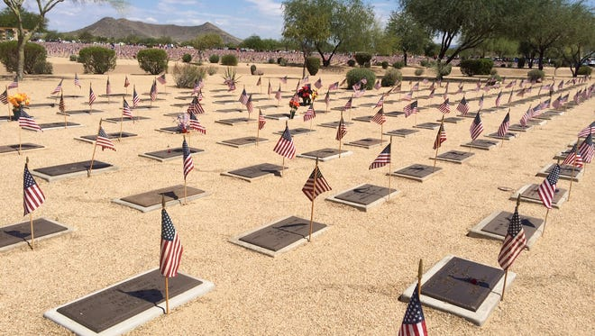 Flags on graves at National Memorial Cemetery of Arizona in Phoenix