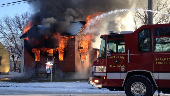 Flames consume this vacant home on North Hickory Street Dec. 9. Shannon Rogler of Fond du Lac is a suspect in the blaze.