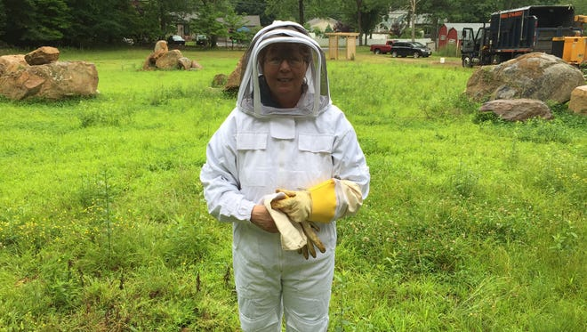 Daily Record reporter Peggy Wright donned a bee-keeper's suit for a close encounter with the honeybees at Roxbury Community Apiary