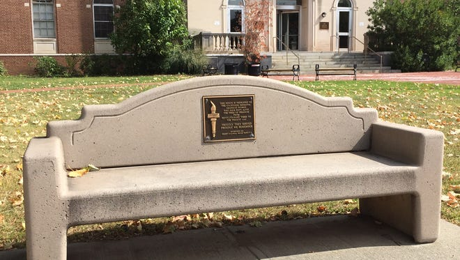 A bench in front of the Morristown Municipal building honors patriotic women.