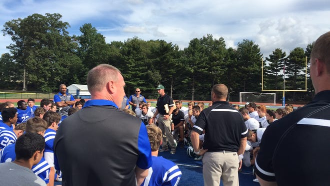 Ridge coach Bill Tracy addresses Red Devils' and Scotch Plains-Fanwood players in tribute to Evan Murray