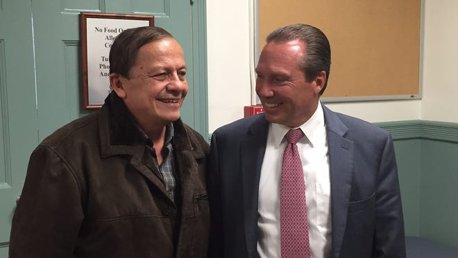 Fabio Aristizabal, left, with defense lawyer Walter Laufenberg, after Aristizabal's acquittal in Superior Court, Morristown, on a vehicular homicide charge.