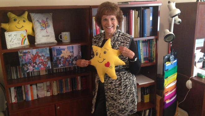 Karen Stone of Mount Laurel is shown in her home office, holding CJ or Creator of Joy, characters she created to help teach children the tenets of emotional intelligence. Stone has an anti-bullying web site and has a book upcoming.