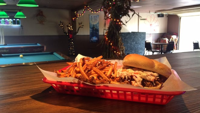 Muddy Boot's pulled pork sandwich is served with fresh-cut french fries and is topped with cole slaw. Muddy Boot is located at 2290 Old River Road in Zanesville.