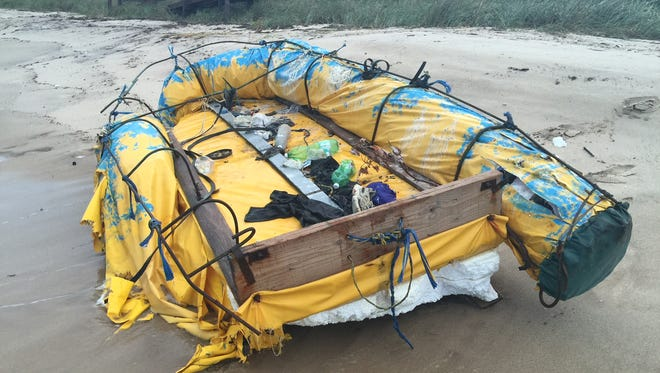 A battered yellow-and-blue, steel-framed raft washed ashore Monday on Brevard County's south beaches.