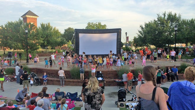 Families prepare for a showing of Moonlight Movies in Greer, which has ranked among the 30 safest cities in the state, according to a report from SafeWise.