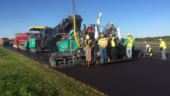Crews repave a portion of a 10,000-foot runway at W.K. Kellogg Airport. The $6 million project is expected to be completed this week.