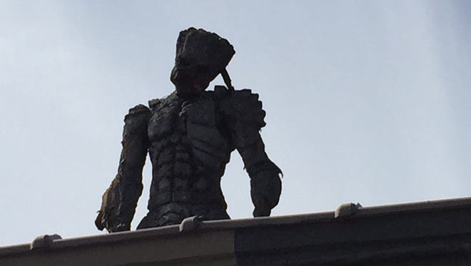 A Predator statue stands over Hydravolve, a tattoo parlor on the White Horse Pike in Somerdale.