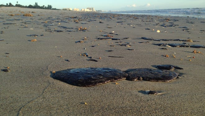Tar dotted the beach Thursday morning, between 4th Street South and 5th Street South in Cocoa Beach.