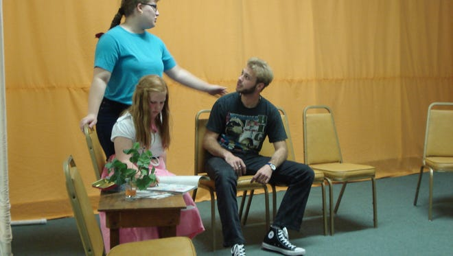 """Rachel Witcraft, standing, works on a scene from """"The Groom Said No!"""" as fellow actors Calleigh Sweetser and James Montellato play their roles"""