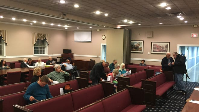 Citizens arrive for a council meeting in Parsippany.